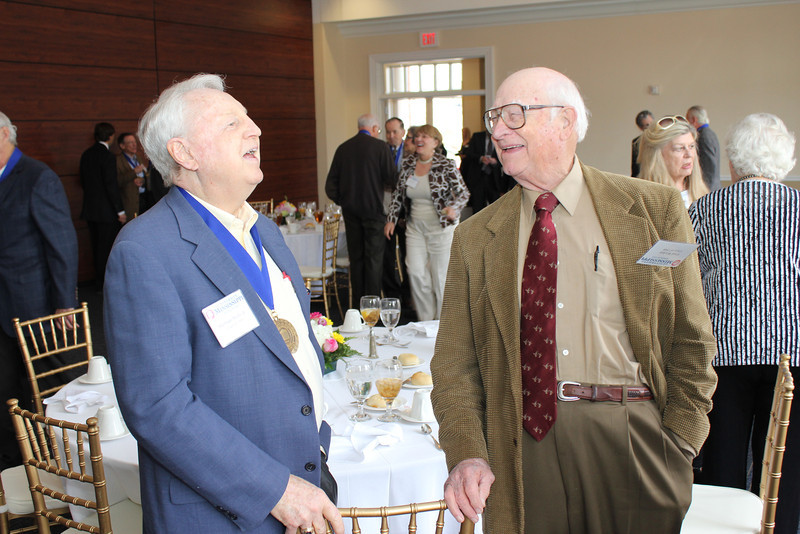 Sherman Muths (LLB 60) and Fred Wicker (LLB 48) share a laugh
