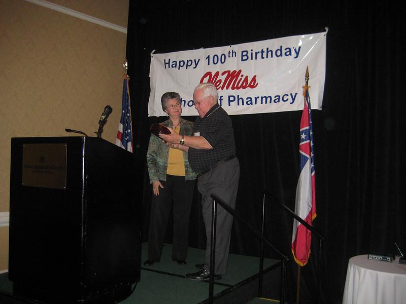 Dean Barbara Wells presents the Dean's Leadership Award to Clint Johnson (BSPh 58)