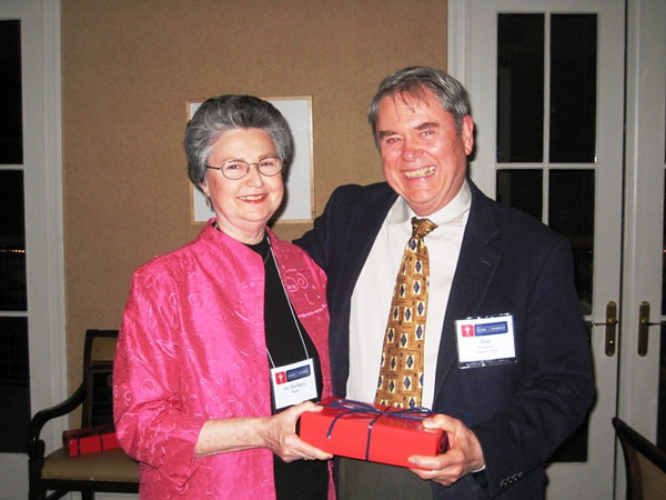 Dean Barbara Wells presents a gift to Bob Buchanan (BSPh 59) to commemorate his 50 year reunion