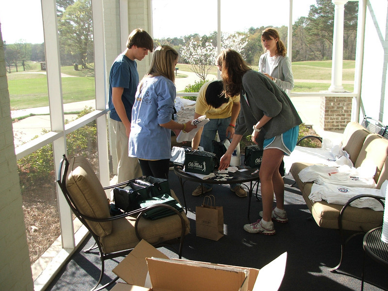 Pharmacy students volunteer their time to prepare for the 2011 School of Pharmacy Scholarship Golf Tournament