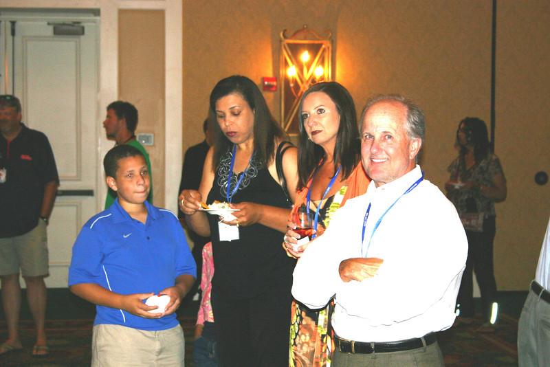 Jim Pittman (BSPh 80) with Associate Dean Leigh Ann Ross (BBA 93, PharmD 98), Kimsey O'Neal Cooper (BSPh 94) and her son, Kobe