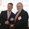 Dean Allen congratulates Gordon Evans (BSPh 63) on 50 years of achievement