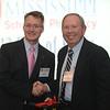 Dean Allen congratulates David Deterly (BSPh 63) on 50 years of achievement