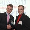 Dean Allen congratulates Durell Hall (BSPh 63) on 50 years of achievement