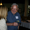 Johnny Odom (BSPh 70) shares a laugh with Raina McClure