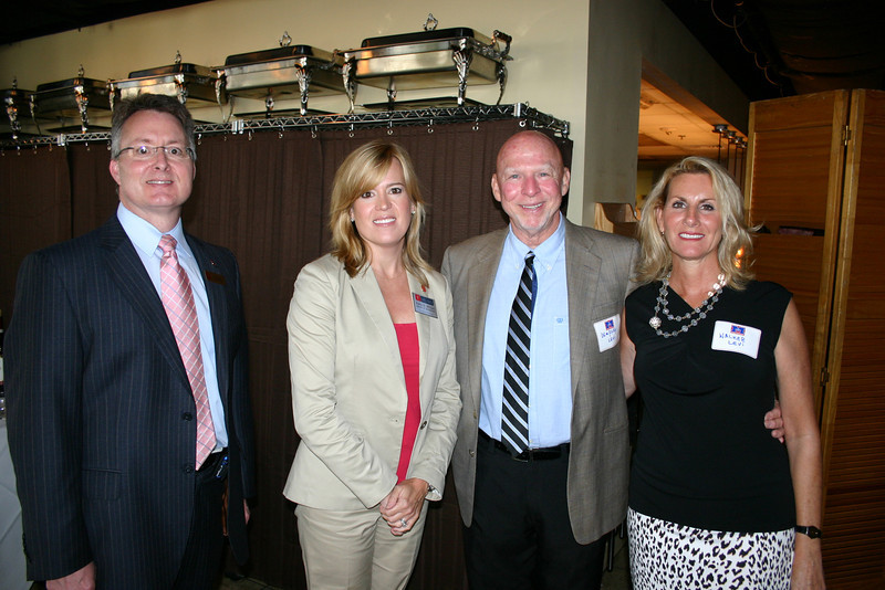 Dean David Allen and Raina McClure with Dempsey Levi (BSPh 65) and his wife, Walker