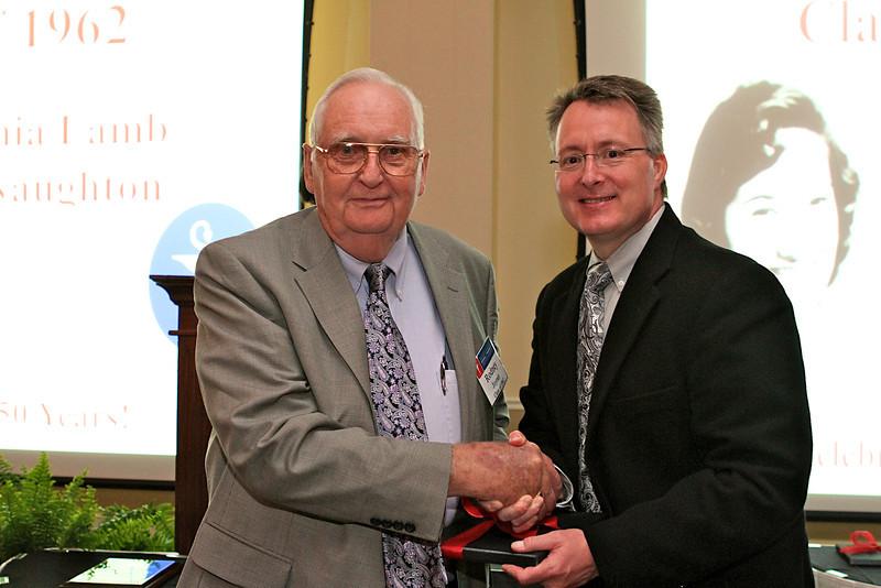 Dean David Allen congratulates Rodney Joyner, who was celebrating his 50th reunion.