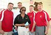 "Coach Greg ""Roz"" Roeszler '74 (on right) and his staff with principal Myrtle Berry"