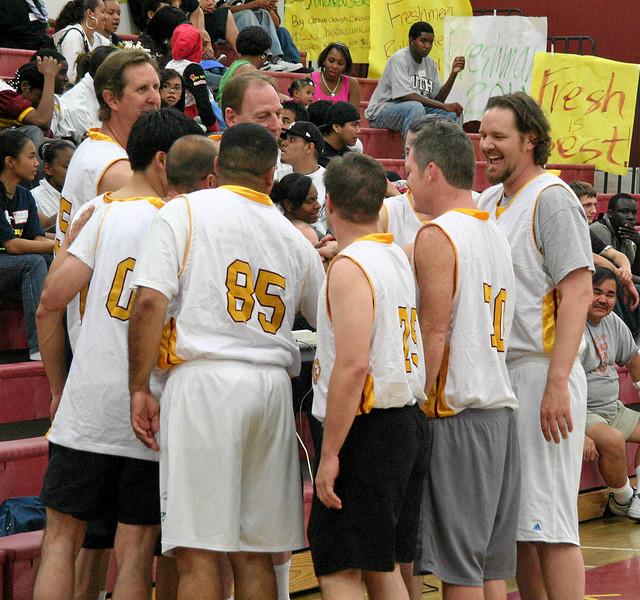 Alumni huddle