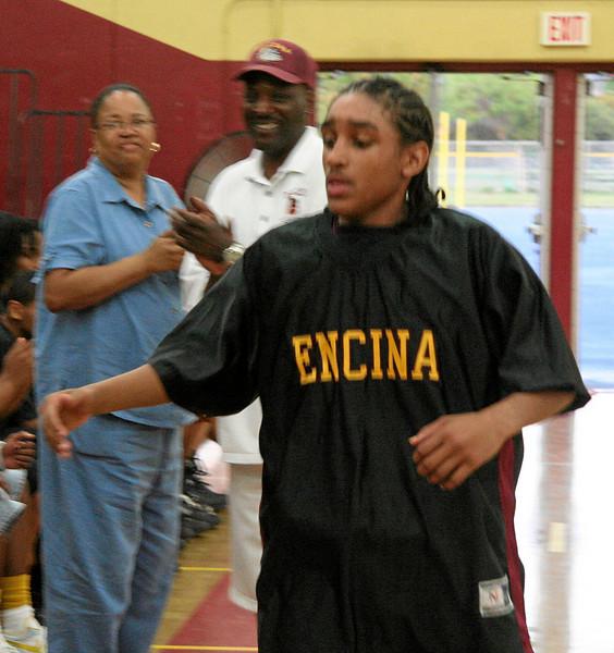 Varsity players run through line. Christopher Renteria