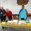 Steve Palmer 74 and Earl Heverly at T shirt and hat sales, benefits to the Encina Booster Club