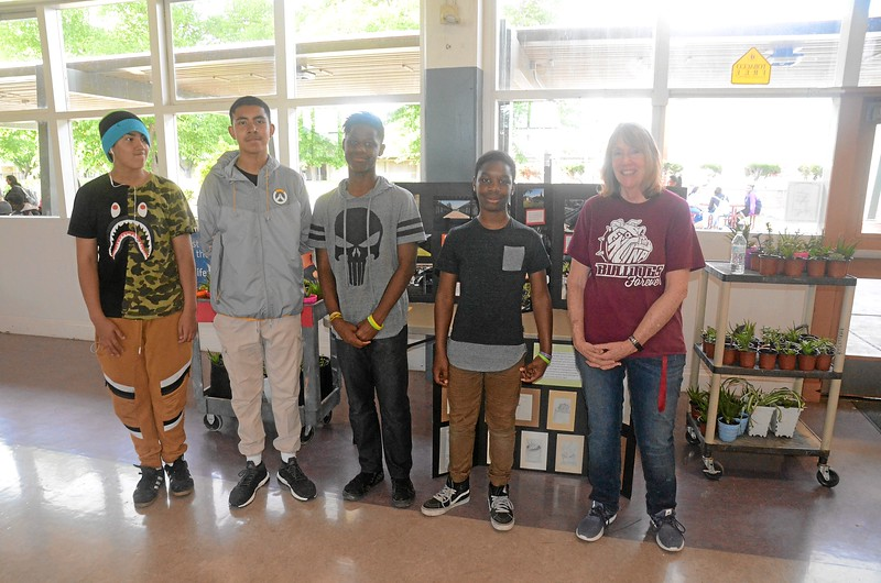 Art teacher and students who are growing plants to sell.