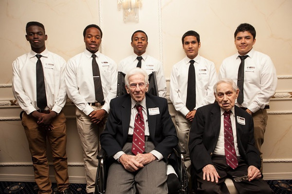 "Charles Manger (seated, left), from the Class of '31, and Henry Lubben, Class of '32, are flanked by the ""Senior Leaders"" from St. Benedict's Class of 2013."