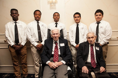 """Charles Manger (seated, left), from the Class of '31, and Henry Lubben, Class of '32, are flanked by the """"Senior Leaders"""" from St. Benedict's Class of 2013."""