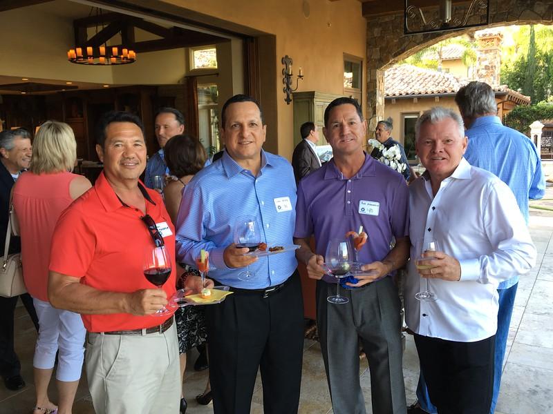 From left: Bill Mandeville '78, Carl Reyes '80, Bob Mandeville '80 and Kieron Foley '74.