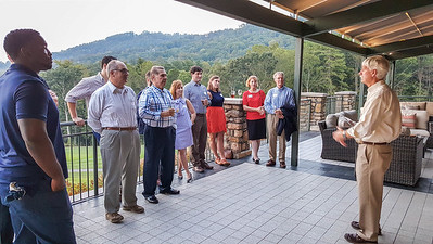 Dean Peter Evans P'98 with Avonians gathered at the Asheville Country Club.