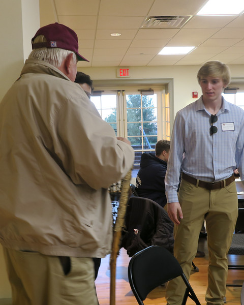 """Poulson """"Pope"""" Reed '63 shows Raines Shamburger '17 the lacrosse stick he played with when he was at AOF."""
