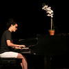 Hannah Staub plays the piano before Fr. Eugene Hensell's day of recollection in the St. Bede Theater on August 2, 2021.