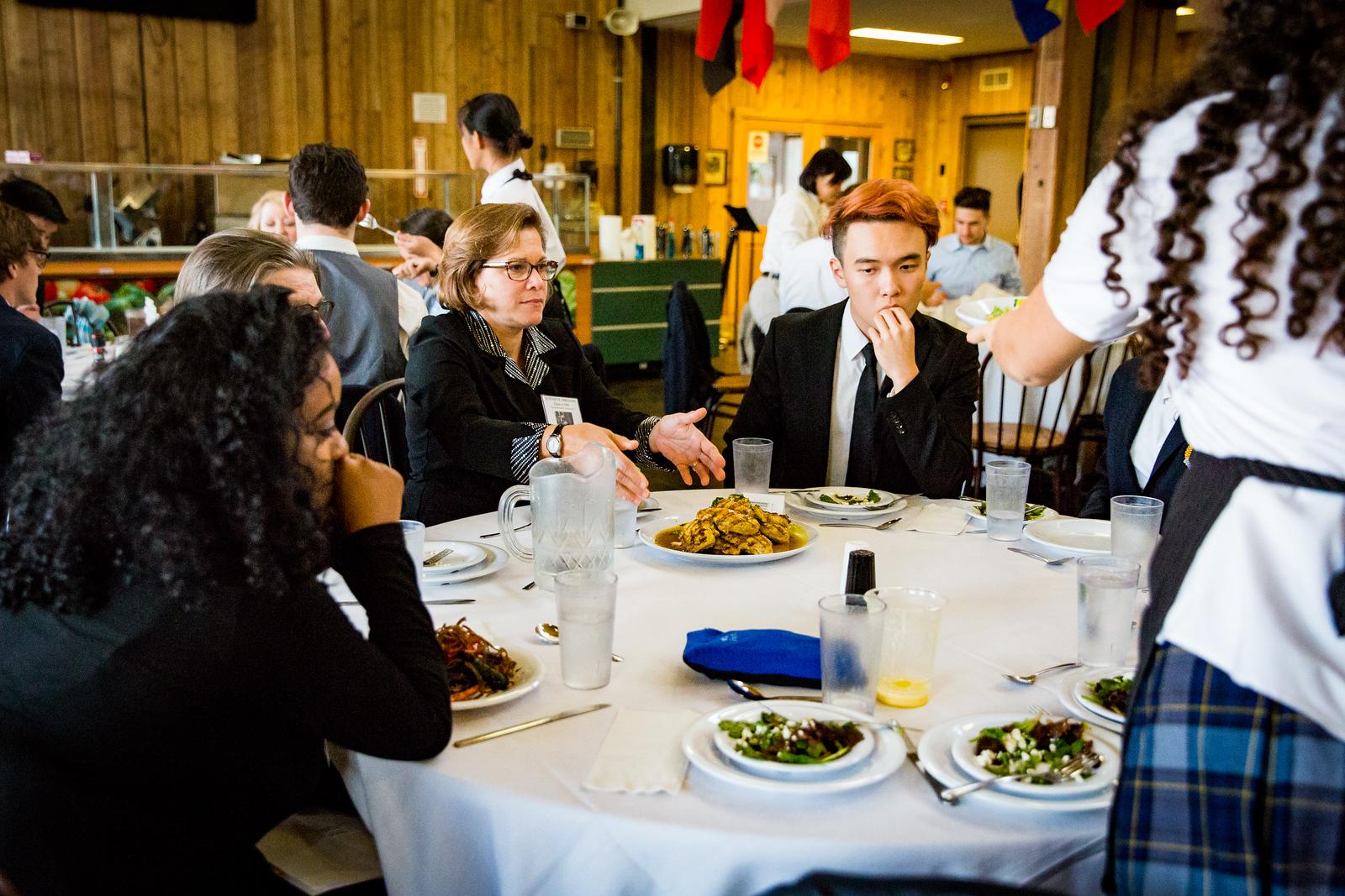 Jennifer Obregon '84 with students at Formal Dinner