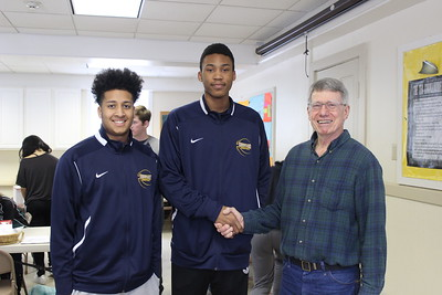 Phil Cameron '64 with 2 SKS basketball players
