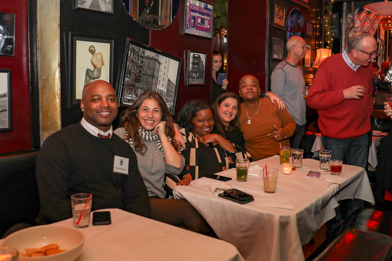 Andrew Banes Down, Yael Becker '97, Daniella Jones '97, Alexandra Caulfield '02 and Shautiece Hunt '01.  Steve Bluth '83 and Mike Brower '63 to the side