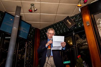 Headmaster Jonathan W.R. Lamb welcoming holiday party guests