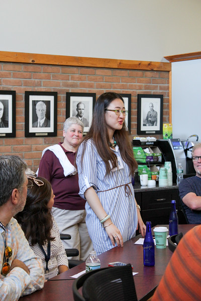 Katrina Wu '13 introduces herself at the Alumni Association Meeting