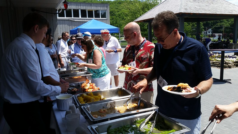 From the left: Justin Abelson '74 and Jim Magid '71 digging in!