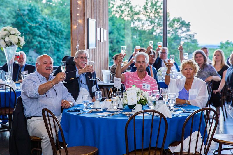 Paul Jerry '69, Don Friedman '68, Bruce '68 and Paula Dennison toast the 150th