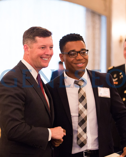 Nikoles Simons hugging with Secretary of the Army, Patrick J. Murphy // nikolessimons@yahoo.com // 856-295-3911