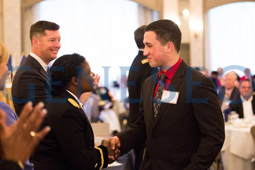 Nicholas Lombardo shakes hands with BG Donna Martin, Deputy Commanding General  — U.S. Army Recruiting Command