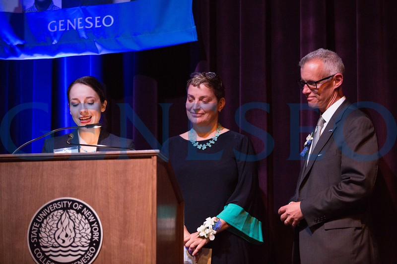 Francesca DiGiorgio '17 presents John '87 and MaryGrace '84 Gleason with the alumni achievement award
