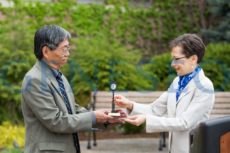President Denise Battles presents a token of appreciation to Eddie Lee, former member of the Geneseo Alumni Association