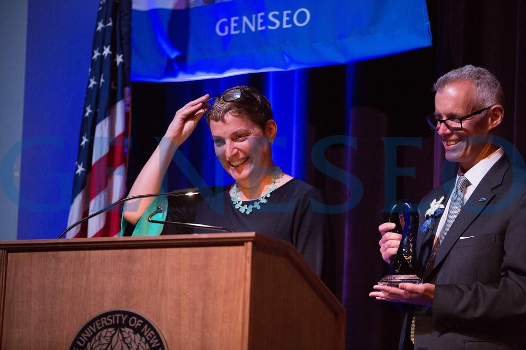 Francesca DiGiorgio '17 presents John '87 and MaryGrace '84 Gleason with the alumni achievement award