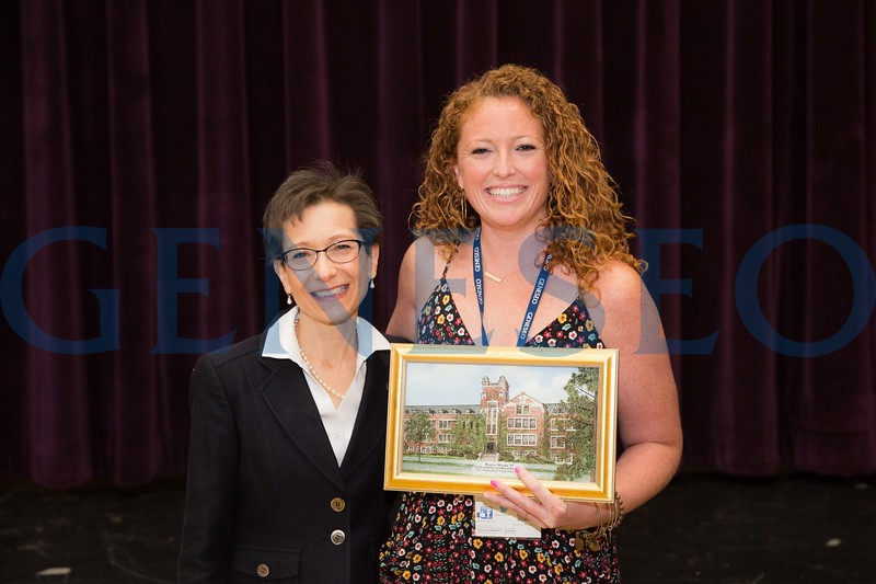 Marissa Mulder '07 receives the Outstanding Young Alumni Award President Denise Battles (left)