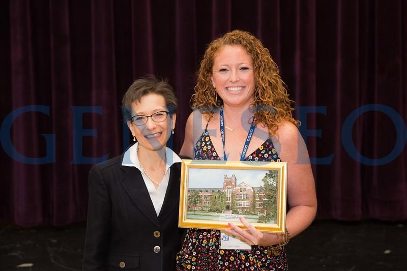 Marissa Mulder '07 receives the Outstanding Young Alumni Award President Denise Battles (left)