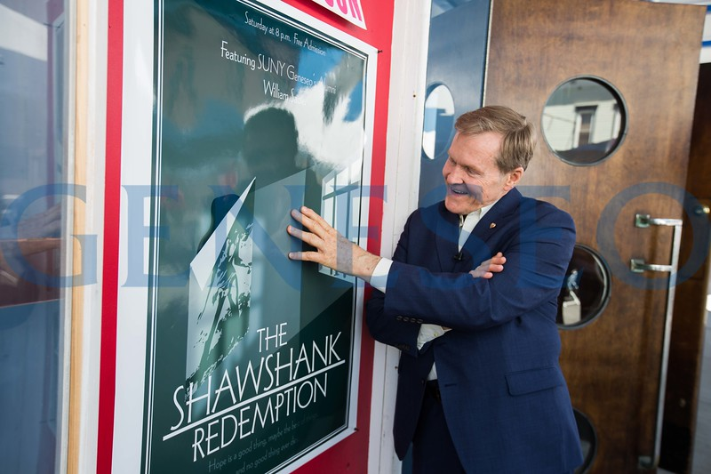 William (Bill) Sadler signs a movie poster outside of the Riviera Theatre