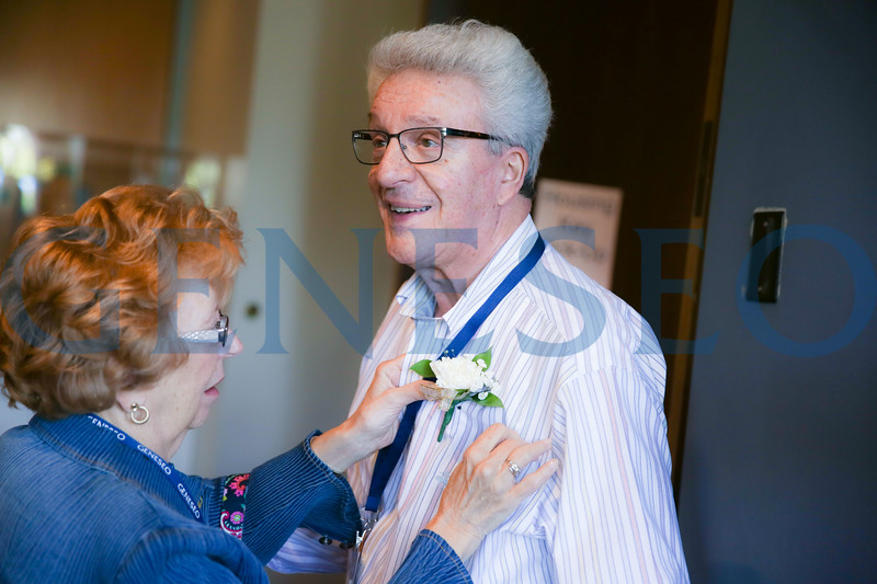 Chuck LaBarbera has his corsage adjusted by Irene LaBarbera