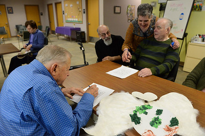 Tania Barricklo-Daily Freeman    Always There Site Coordinator Donna Slavin, rear center, and volunteer Mike Sanchez, rear left, help Bill Glennon of Kingston, a participant at Always There, with  coloring some lettering for the Global Peace Project the group is undertaking.To the left is Gil Hales of Sauerties, another participant in the Adult Day Program.The program at  Always There is a Social Day Program that offers cognitive and physical stimulation for particpants in need of supervision and a respite program for caregivers.The group is contributing art to the Global Art Project for Peace which includes 15,000 artists joining in a worldwide, multicultural celebration of peace and diversity durting the week of April 23-30.According to the project website, thousands of messages of global goodwil will simultaneously encircle the Earth as artists exchange their personal expressions of peace. Always There is exchanging with a groups in Arizona and Malaysia.