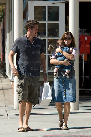 Alison Hannigan and husband Alexis Denisof and baby make shopping in Beverly Hills.
