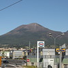 Mount Vesuvius.  It is best known for its eruption in AD 79 that led to the burying and destruction of the Roman cities of Pompeii and Herculaneum, as well as several other settlements.   It is still active, and has erupted several times during the 20th century.