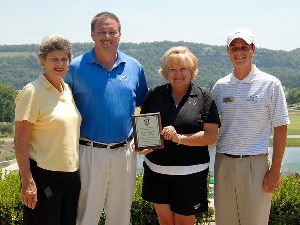 Chairperson Jeannie Hindman, Steve Belton, General Manager, Kathy Wise, Local Tournament Coordinator, and Ryan Mansalle, Head Pro at Osage National with MWGA Appreciation plaque.