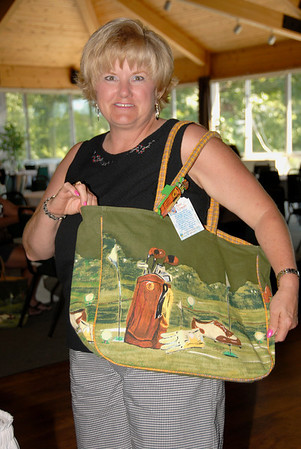 Local Tournament Coordinator, Kathy Wise, models the players' gift.