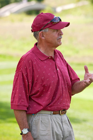 "Volunteer John Johnson, member at The Club at Old Hawthorne mans the ""risk vs reward"" hole, No. 8."