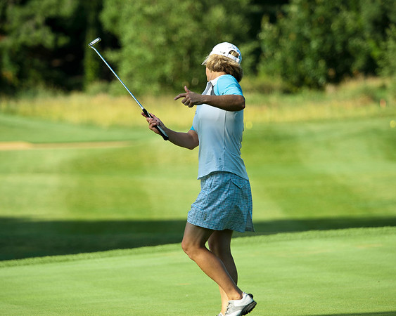 Ellen Port, St. Louis encourages a putt to fall on her first hole.