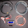 Contents of accessory can (L to R, top to bottom) Dual band roll-up J pole antenna, 25ft RG-8X coax, alligator clips for battery charger, Tergeney battery monitor, 6 ft cable for connection between battery box and radio box.