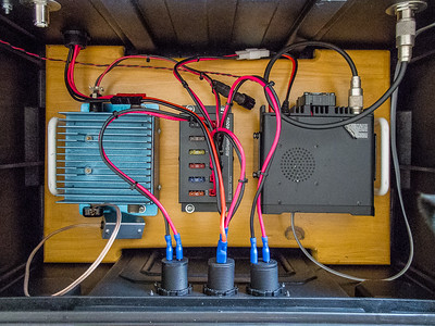 Lower portion of the radio box with everything wired up.  Power comes in at upper left, runs to the volt/amp meter, then to the RigRunner and out to the radio, 2 meter amplifier, USB charging ports and lighter socket.