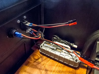 Wiring for switch and voltmeter.  The top wires come from the battery and bottom wires go to the power outlet and the voltmeter next to the switch.