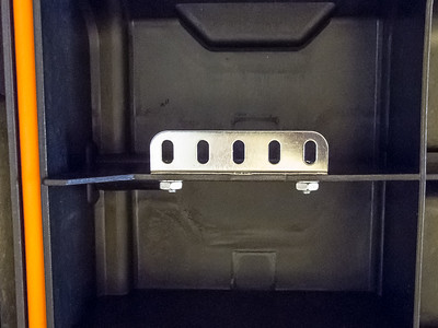 Closeup of the white board mounting brackets