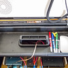 Tray in the top of the radio box containing whiteboard pens, eraser, clip-on light and power switch lock.